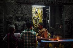 Priest business (Scalino) Tags: india karnataka tourism belur halebid halebeed halebeedu hoysala temple carved sculpture priest hindu pooja ritual spirituality dark
