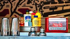 Burger Counter (clif_burns) Tags: burgers condiments food hamburgers ketchup mustard restaurants shakers tastyburger washingtondc
