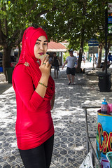 Lady in Red Ko Phi Phi Don Thailand (Anoop Negi) Tags: thailand ko ph phi don andaman sea resort portrait lady red muslim moslem coconut ice cream vendor seller commerce island anoop negi ezee123 photo photography fashion glasses styling local