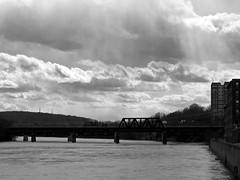 Haverhill Train Bridge BW (Boneil Photography) Tags: silhouette clouds ma 50mm asahi pentax takumar panasonic m42 sunrays manualfocus 50mmf14 trainbridge haverhill screwmount supertakumar m43 microfourthirds boneilphotography dmcg10 brendanoneil