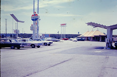Standard station, near Chicago, 1968 (STUDIOZ7) Tags: chicago cars restaurant illinois 60s coffeeshop automotive gas gasstation il oil summertime 1960s roadside gasoline standard sixties amoco motorclub petroliana carriageinn americanoil asyoutravelaskus