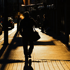 Good morning, Vancouver (. Jianwei .) Tags: morning silhouette yellow backlight vancouver mood cigarette candid smoking backview morningsun cordovast a55 kemily