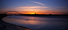 Dying Embers (Silty Bottom) Tags: bridge sunset sky sun clouds river mersey jubileebridge runcorn rivermersey runcornbridge