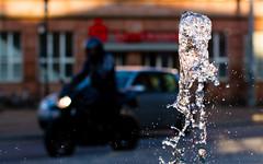 Black rider (tom.leuzi) Tags: street city sunset urban water car germany deutschland lights drops wasser sonnenuntergang dof bokeh dusk outoffocus motorbike motorcycle splash lichter saarland saarbrcken motorrad canonef50mmf14usm canoneos7d