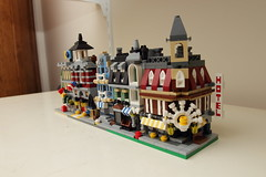 mini buildings (s4turn17) Tags: corgi lego transformers snoopy planes smurfs matchbox diecasts toyroom