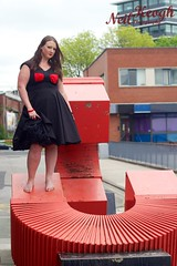 IMG_4469 (Neil Canon Keogh) Tags: red black vintage necklace highheels dress retro ring redhead bow buskers bracelet heels rockband pinup pinupgirl trianglesquare manchestercitycenter dressmodellaura