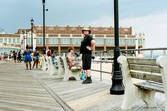 boardwalk explorer (mfauscette) Tags: 35mm fsc ishootfilm istillshootfilm kodak kodakportra400 nikon nikonf6 analog asburypark beach boardwalk film filmisnotdead filmshooterscollective jerseyshore sand street
