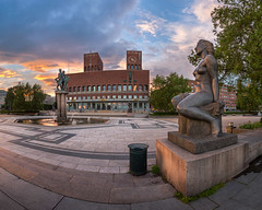 Oslo City Hall in the Evening, Oslo, Norway (ansharphoto) Tags: city travel blue sunset vacation sky urban panorama sculpture building tree tower history clock tourism water fountain oslo norway statue skyline architecture modern facade square evening town hall twilight europe european cityscape exterior view outdoor dusk cityhall famous capital landmark illuminated norwegian capitol townhall nordic scandinavia iconic radhuset guildhall scandanavia