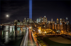 **15 SEPTEMBERS LATER** (**THAT KID RICH**) Tags: richzoeller rich zoeller thatkidrich tkr 911 tribute lights tributeinlights wtc september 15 night nightphotography moon sky clouds neverforget trails motion brooklynbridge newyorkcity ny nyc skyline remember reflections water river canon nypd boat