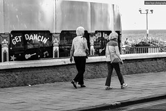 Bridlington - get dancing! (SteveH1972) Tags: canonef70200mmf28lusm canon700d canon 700d seaside coast 2016 eastyorkshire northernengland britain outdoor outdoors outside blackandwhite monochrome woman women streetphotography street