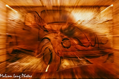 Burning beetle (Malcom Lang) Tags: vw beatle car burning paint painerly digital fire rust auto automobile rusty brown red yellow white frame volkswagen zoom blur canoneos6d canon canonef2470mm canon6d canonef malcomlang malcomlangphotos mal driving wheels door light lights