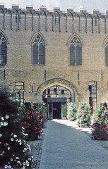 Belgium.  June 20th. 1999 (Cynthia of Harborough) Tags: 1999 architecture arches courtyards doorways entrances flowers halls paths