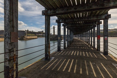 Whitby Pier (scarlet-pimp) Tags: wood symmetrical landscape promenade pier beams scarborough storylighthouse longexposure scotchhead tatehillpier westpier riveresk northyorkshire ladder whitbyabbey churchofsaintmary ndfilter symmetry whitby nd10 architecture horizon civilengineering canon5d harbour boxingring england unitedkingdom gb