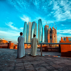 when past, present and future decide to meet (~mimo~) Tags: street city sky people urban color men skyline photography traditional towers uae emirates abudhabi future present past abayas emiratespalace mimokhair