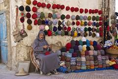 Hat Seller, Essaouira (Peter Cook UK) Tags: hat wall crochet morocco seller essaouira crocheting jellaba