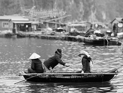 Little Lady in a Rowboat (O.Connell.) Tags: travel ladies vacation blackandwhite water canon boat vietnam rowing rowboat halongbay canon200mmf28l canon5dmarkii ecofriendlytours