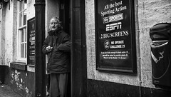 english pub doorway (streetstory) Tags: street uk england people urban blackandwhite monochrome canon photography mono places lancashire preston pancake 40mm socialdocumentary northernengland streetstory johnnydurham april2013 4tografie