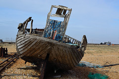 rear end view (The Urban Adventure) Tags: blue sky urban abandoned beach 35mm boats coast wooden chains kent fishing nikon rust bokeh pebbles shipwreck naturereserve dungeness derelict fishingnets d7000