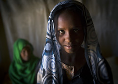 Nubian Girl With Her Grand Mother, Bagrawiyah, Sudan (Eric Lafforgue) Tags: africa portrait smiling horizontal photography kid day child northafrica soedan sudan indoors niqab 2people twopeople soudan northernafrica traditionalclothing realpeople traveldestinations colorimage lookingatcamera headandshoulder childrenonly  szudn sudo  northernsudan northsudan      xuan eri1950