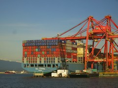 Container ship unloading in Vancouver (Ruth and Dave) Tags: ocean blue sea orange vancouver big dock ship harbour crane cargo container huge inlet burrardinlet enormous unloading portofvancouver molmodern