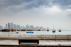 Doha view during a cloudy weather today (Abdulla555) Tags: travel sky water clouds reflections landscape boats raining doha qatar skyview