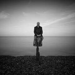 I'm not ashamed. I have known love. (martinfowlie) Tags: longexposure sea england sky blackandwhite selfportrait man beach clouds suffolk stones horizon shingle jacket beacon aldeburgh loner 40s leftfield shallowgrave lmort