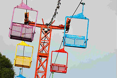 Hanging Windows (Aljone) Tags: carnival blue windows red color colors yellow contrast flying lift shapes violet lifts