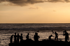 Tanjung Layar Sunset Crowd (Alexander Ipfelkofer) Tags: life longexposure travel sunset people seascape beach silhouette kids indonesia landscape rocks asia joy happiness contrejour sawarna banten tanjunglayar