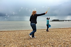 Bubbles on the beach (pugwash00) Tags: uk boy sea portrait england woman beach water kids coast pier kent europe bubbles pebbles deal frisbee fujifilm x100