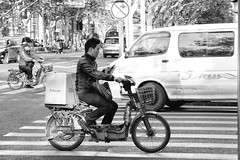 on the road (Swissrock) Tags: china street bw mobile drive blackwhite shanghai traffic streetshot streetphotographie nikond700 moitorcycle