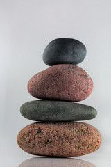 Pink and Grey Cairn (KellarW) Tags: stone rock four riverstone cairn balance stackedfocus softlight brown macro stones pastel stack rocks 4 stackfocus riverstones grey onwhite pink balancedisolation balanced green stacked pale isolation gray