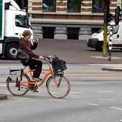 Colorful (FaceMePLS) Tags: amsterdam nederland thenetherlands facemepls nikond5500 straatfotografie streetphotography tweewieler man fiets bike bicycle pet cap schoudertas transportfiets rugzak fietstas nikesneakers johnnyloco