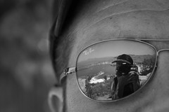 Through the Eyes of a Friend (Axel) (parenthesedemparenthese@yahoo.com) Tags: dem bw blackwandwhite ete nb noiretblanc photographer reflection rodos selfie blancoynegro bn byn canoneos600d cotes ef50mmf18ii glasses greece holidays lindos lunettes mer reflexion sea seashore summer vacances