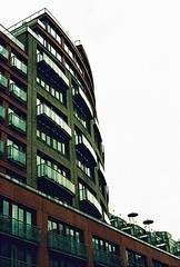 Roll 2 - Waterside Apartments (Cris Ward) Tags: street camera old city uk orange streets color colour building slr london art film yellow architecture rollei analog 35mm vintage daylight lomo xpro lomography construction warm cross britain crossprocess grain slide retro architect crossprocessing april analogue manual noise processed e6 yashica blown colorshift lsi c41 2013 yashicafxd colorreversal cr200 lomolab digibase rolleidigibasecr200