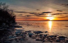 St. Lawrence River Sunset (Nicolas Goulet Photography) Tags: sunset sky sun canada ice clouds canon river dark lens photography lawrence quebec photos freeze 5d dslr 100commentgroup