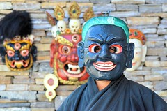 The Bhutanese Behind A Mask.........Gross National Happiness (pallab seth) Tags: festival religious dance mask bhutan religion culture buddhism sacred spiritual performer bhutanese thimphu maskmaker peopleportraits performingart grossnationalhappiness maskdance tshechu chamdance