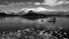 Lochan na h-Achlaise (Andrew Lockie) Tags: snow mountains ice landscape mono scotland frozen highlands fuji argyll scottish glencoe capped rannochmoor munro xe1 blackmount lochannahachlaise achallader ammonadhdubh