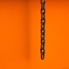End of the chain (wuwei2012) Tags: shadow orange abstract metal dumpster rust minimal chain container abstraction 20130416734