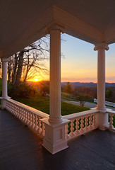 Morning View from Cone Manor (Sugar Mtn Photography) Tags: morning sunrise columns northcarolina porch blueridgeparkway sunstar mosesconemanor daleking sugarmountainphotography