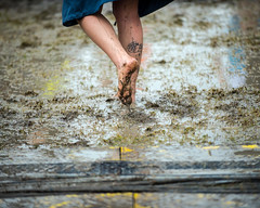 Dancing In The Deluge (Lane Rushing) Tags: feet louisiana mud neworleans bigmomma storybookwinner jazzfest2013