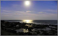 Moonrise over the ocean (PaulE1959) Tags: ocean moon evening nikon rocks moonrise p100