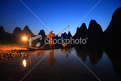 Fishermen fishing (MPBHAIBO) Tags: china morning travel blue mountain reflection night sunrise river landscape dawn liriver fishing fisherman guilin yangshuo hill cormorant chineseculture mountainpeak fishingindustry asianculture lightingequipment peopletraveling karstformation nauticalvessel chineseethnicity woodenraft asianstyleconicalhat guangxiregion