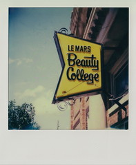 Beauty College (DavidVonk) Tags: film college beauty sign analog vintage polaroid iowa instant slr680 lemars impossibleproject