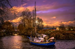 Surreal lighting (Images by Christie  Happy Clicks for 2016!) Tags: sailboat sunset woodenboat skylight cloudsstormssunsetssunrises clouds water storm lightstar seascape newwestminster bc canada sapperton sappertonlanding brunettefraserregionalgreenway brunettefraser regional nikon d5200 twilight riverbank river fraserriver brunette brunetteriver park