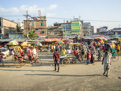 Traveling out of Dhaka (karla.hovde) Tags: building architecture outdoor city urban travel asia bangladesh dhaka road market bazar people crowds crowd bicycles rickshaw fruit food