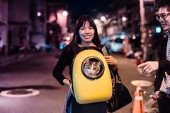 Cat Backpack (Jon Siegel) Tags: nikon nikkor d810 50mm 12 50mmf12 cat backpack neko bag spaceship astrocat korean korea seoul woman girl cute kitty kitteh night evening street people funky