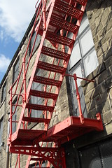 Red Escape. (Stockton8) Tags: door camera red west mill window stone wall stairs fire iron factory escape security lancashire redrule rule craven wrought