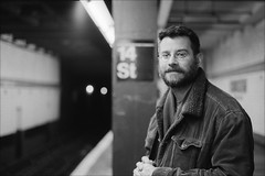 Sean, at the 14th St. Station (Adam Chin) Tags: nyc bw newyork subway zeissikon fujineopan400 14thststation zeissbiogon35mm20