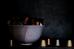 blue bowl and coffee capsules (overthemoon) Tags: blue black dark ceramic 50mm grain bowl bookshelf billy aluminium capsules bestofr gccifpainters avatiinspired