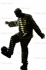 man prisoner criminal playing soccer with chain ball (Franck Camhi) Tags: shadow people white playing man male silhouette ball cutout person one 1 justice costume trapped funny escape adult soccer profile humor fulllength humour player chain indoors criminal whitebackground crime thief law studioshot capture sideview convict punishment isolated striped oneperson prisoner captivity burglar caucasian jailbreak oneman escaping ballandchain